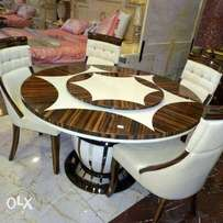 Quality round marble dining by six with six chairs