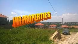Beautiful 50 by 100ft plot for sale in Kisaasi Kulambiro at 60m