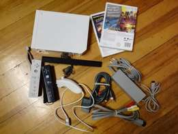 Nintendo Wii - Includes Remotes, Accessories and Games