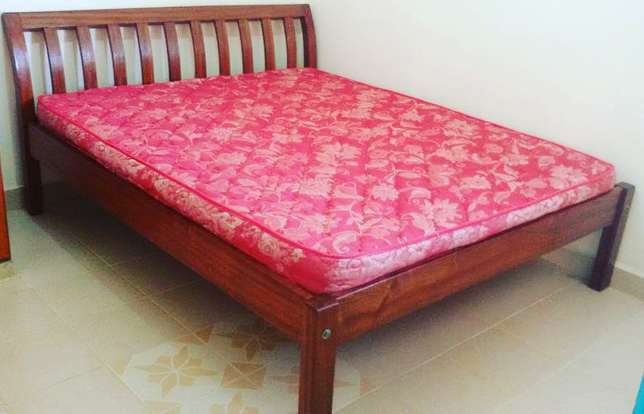 Wooden bed with mattress Ngara - image 1