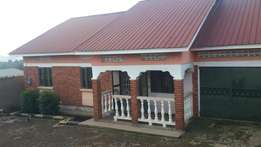 Residential 4bed roomed house with3 boys quaters seeta namilyango road
