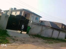 Distressed Solid blk of 7Flats at blueview Game den Estate Oke Aro