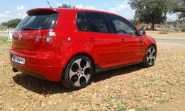 Good day, I'm selling my Golf 5 2.0 GTI DSG which is red in colour and