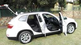 2014 BMW X1 WITH Sunroof hatch back for sale.