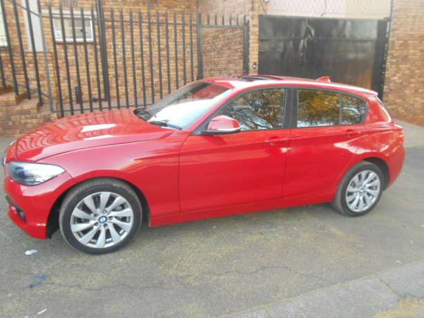 BMW 118i, 2015 model, Red in color, Automatic with a sunroof for sale Johannesburg - image 3