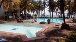 Executive 2 bedroom BEACH FRONT Apartment with swimming pool