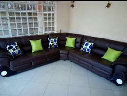 Brown leather seven seater corner Couch