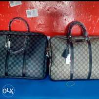 LV and Gucci laptop bags