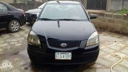 Clean kia rio by nd us working perfectly fine full A C first body