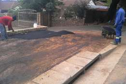Tarring and paving industrial and residential , complexes etc