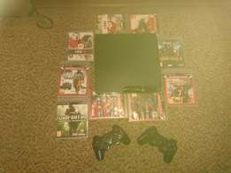 Playstation 3 plus 9 games and 2 remotes. 320 gig hd.