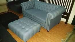 Grey buttoned two seater box sofa, available on order at 380000/=