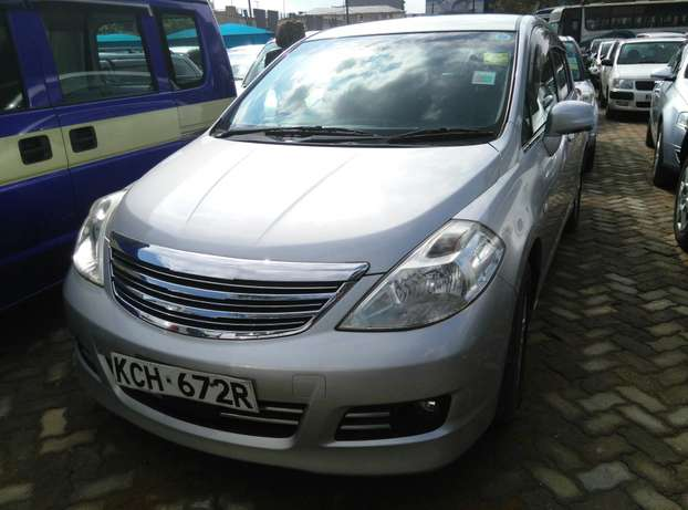 Silver Tiida ax15 ,2009 Model,1500cc,Alloy Wheel,Semi-leather Seats, Nairobi CBD - image 3