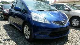 Super clean blue Honda Fit 1.3L 2009 model.Buy on hire-purchase!