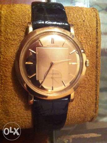 Movado Automatic gold watch
