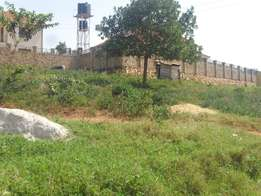 A precious plot (100x100ft) for sale in kisasi-kulambiro at 100m