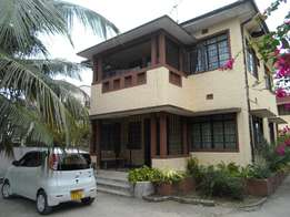 spacious 4 bedroom mansion own compound with separate spacious Godown.