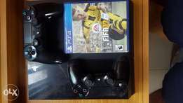 Playstation 4 with 2 dual shock pad and Fifa 17 for sale