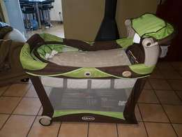 Graco top of range camp cot with vibration and night light music