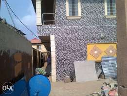 A spacuious mini flat is up for rent at ikotun road.