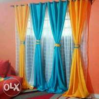 Plain colourful curtain and sheers