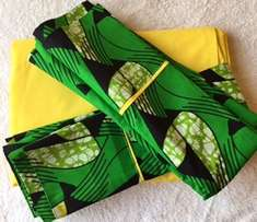 bed sheet (plain yellow) + abada pillowcases (green)
