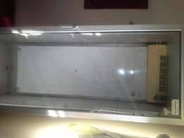 Hi Tec Tall Refrigerator with glass door and trays, available for sale