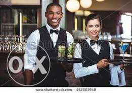 Cocktail waiter and a bar waiter