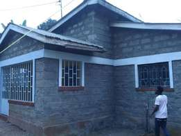 A 3 bedroom house plus 6 singles at kinoo near the DO's office for 9M
