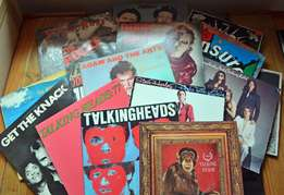A mixture of 26 (New Wave, Punk Rock, Glam Rock, etc) used vinyl LPs