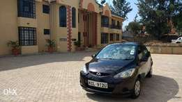 Only 7 mth old wine red MAZDA DEMIO 2010 (careful owner moving abroad)