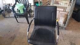 Leatherette visitor chairs