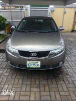 clean kia cerato with mileage 113562 for a give away price