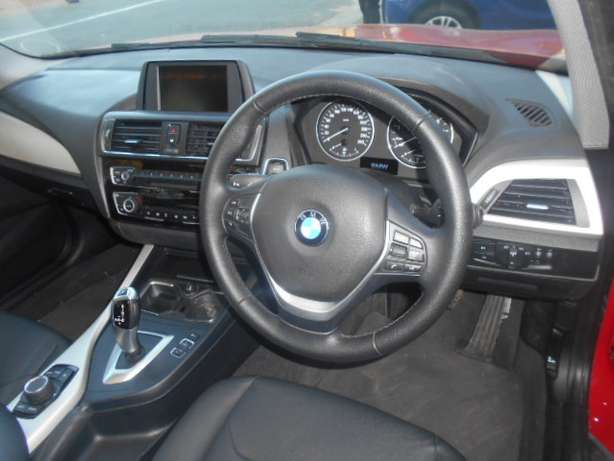 BMW 118i, 2015 model, Red in color, Automatic with a sunroof for sale Johannesburg - image 6