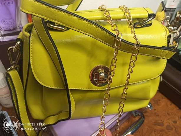 Hand bag new with golden chain strap