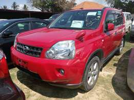 Red Nissan extrail KCN