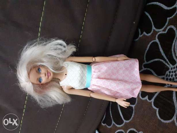 Barbie doll as new