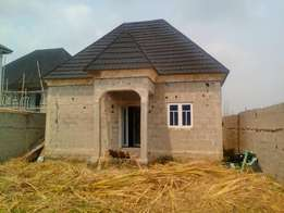 A 2 Bedroom Bungalow With A 5 Bedroom Duplex For Sale At Ado-Soba Town