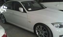 BMW 320i pearl white colour.