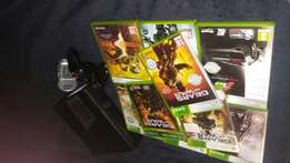 XBOX 360 + remote + 9 games and rechargable batterypack