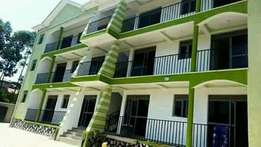 Neat double for rent in Kyaliwajjala at 400k