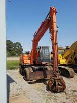 2002 Hitachi wheeled excavator with grab