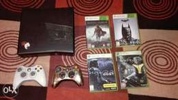 Black XBOX 360 for Sale. 2 remotes (white & silver). 4 games.