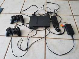 ps 2 Sony console with accessories