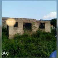 1 plot of land with a 4 bedroom flat project on it at Ojoo Area