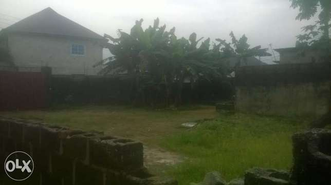 Fenced land with 2 gates and an uncompleted structure at eleparanwo Port-Harcourt - image 4