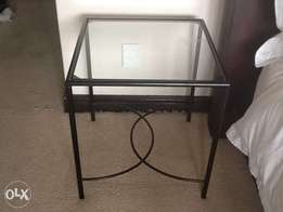 Small glass top side table with wrought iron bottom