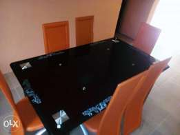 New classy six seater glass dining table