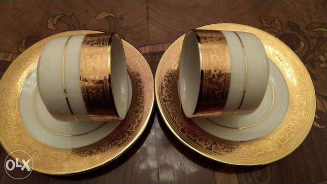 Two Porslaine Turkish coffee cups and saucers (golden plated)
