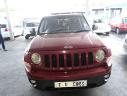 Red 2013 jeep limited